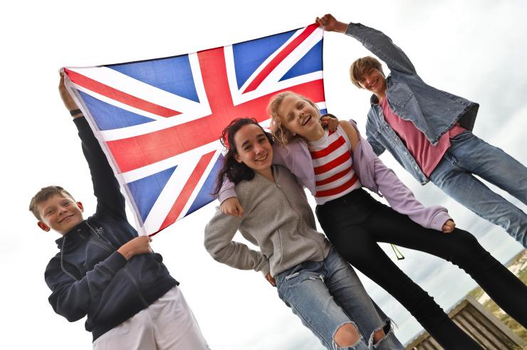 Englische Camp-Gummistiefel im Sand